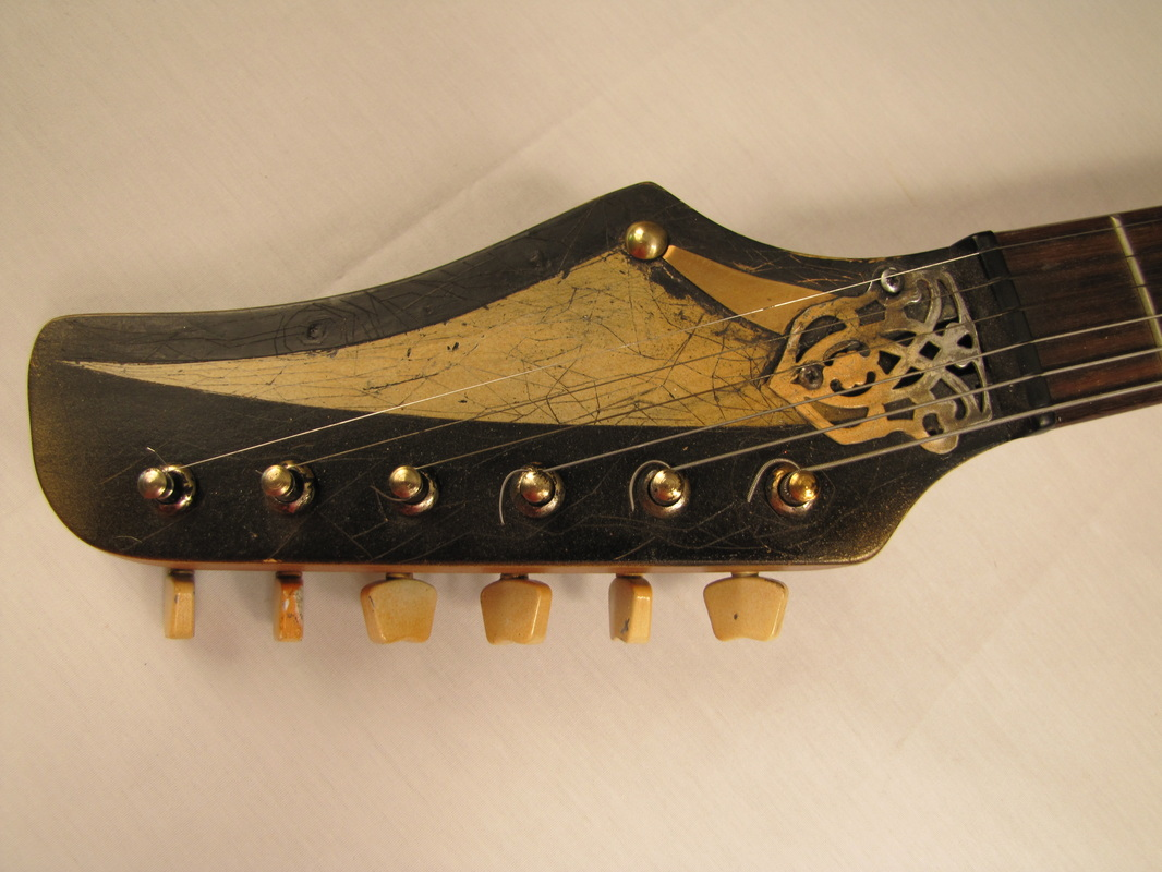 Accodiancaster guitar front head Picture