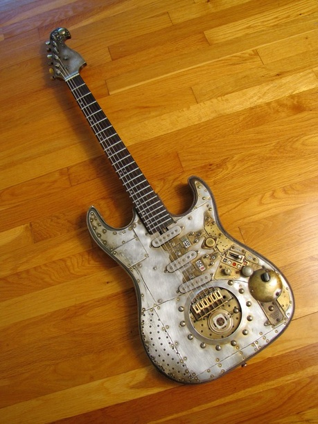 40/50 Guitar on wood front Picture
